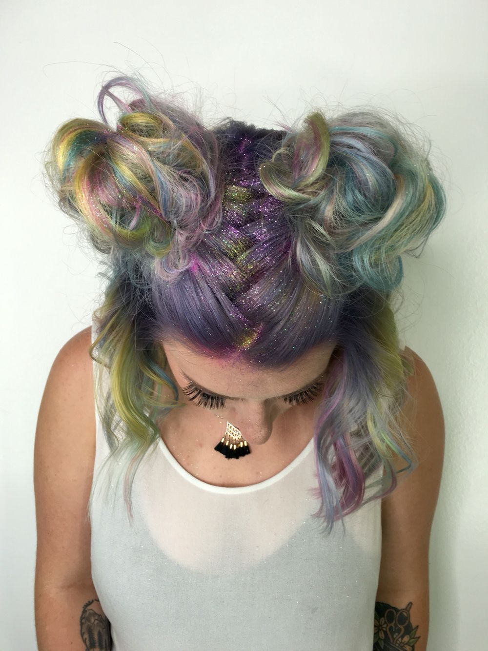 Glitter roots and space buns.