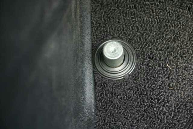 High beam light switch in the floor board