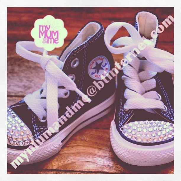 Infants: black Hightop Converse. £35.00