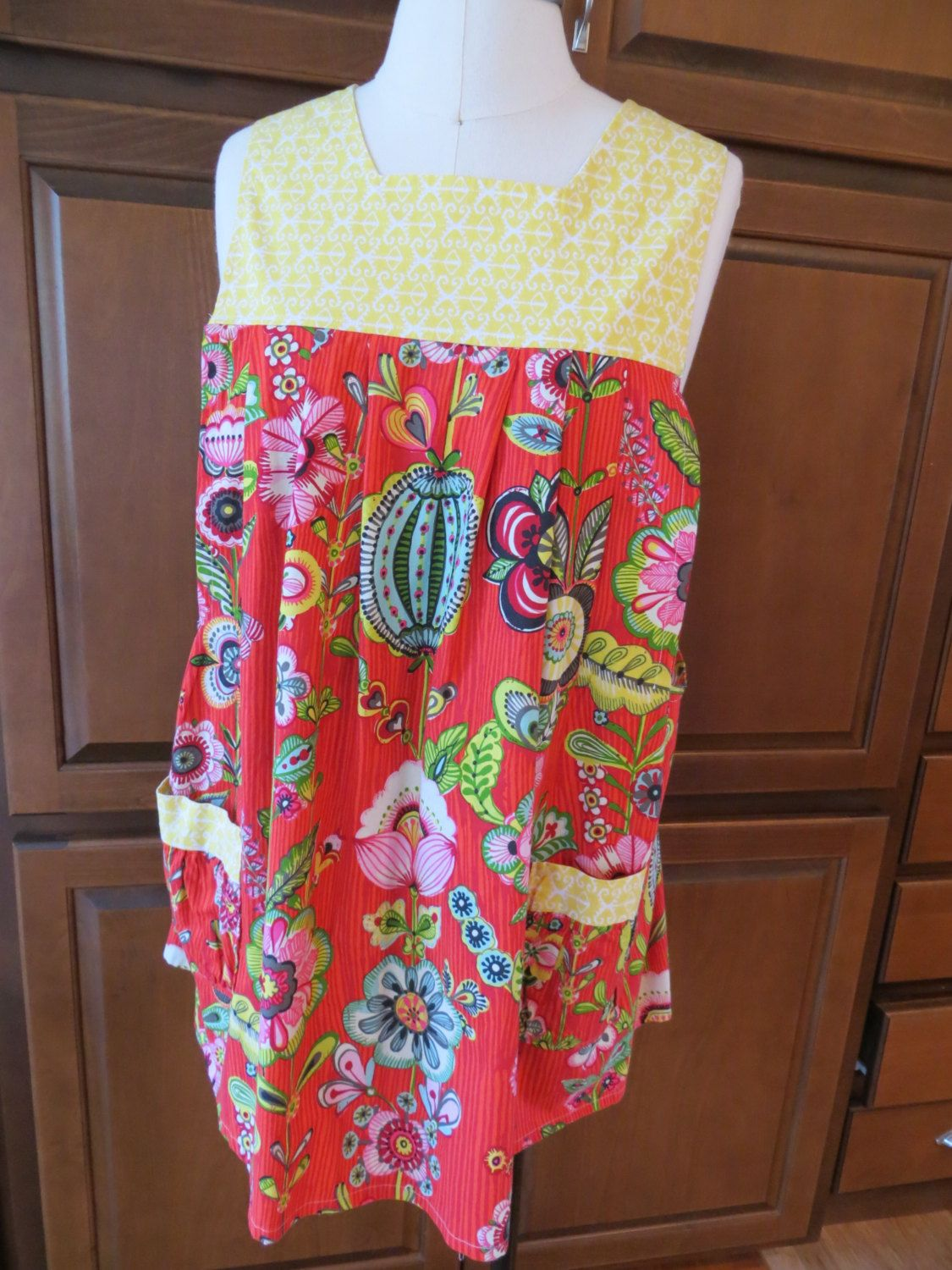 A personal favorite from my Etsy shop https://www.etsy.com/listing/219431985/apron-pullover-smock-style-apron-with