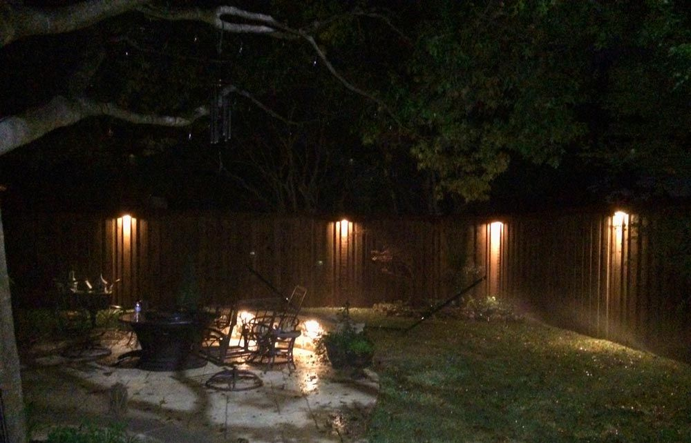 Dallas Landscape Lighting Uses Downlights Mounted High Up On Fences And Walls To Create Ethereal Columns Of Li Landscape Lighting Spa Lighting Outdoor Lighting