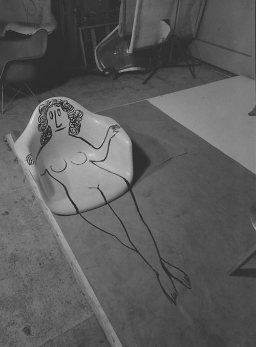 Saul Steinberg drawing on an Eames chair