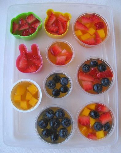 Jello cups, non-sugary version - 1.25 cups juice or a little less to one envelope of gelatin for a firm but not hard texture), put pieces of fruit in the cups in the fridge container first, then fill with the gelatin liquid