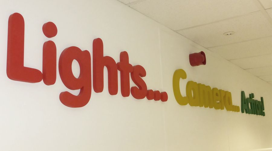 'Lights...Camera...Action!' acrylic letters above school stage. Decorative letters for school drama staging area. By space3.co.uk