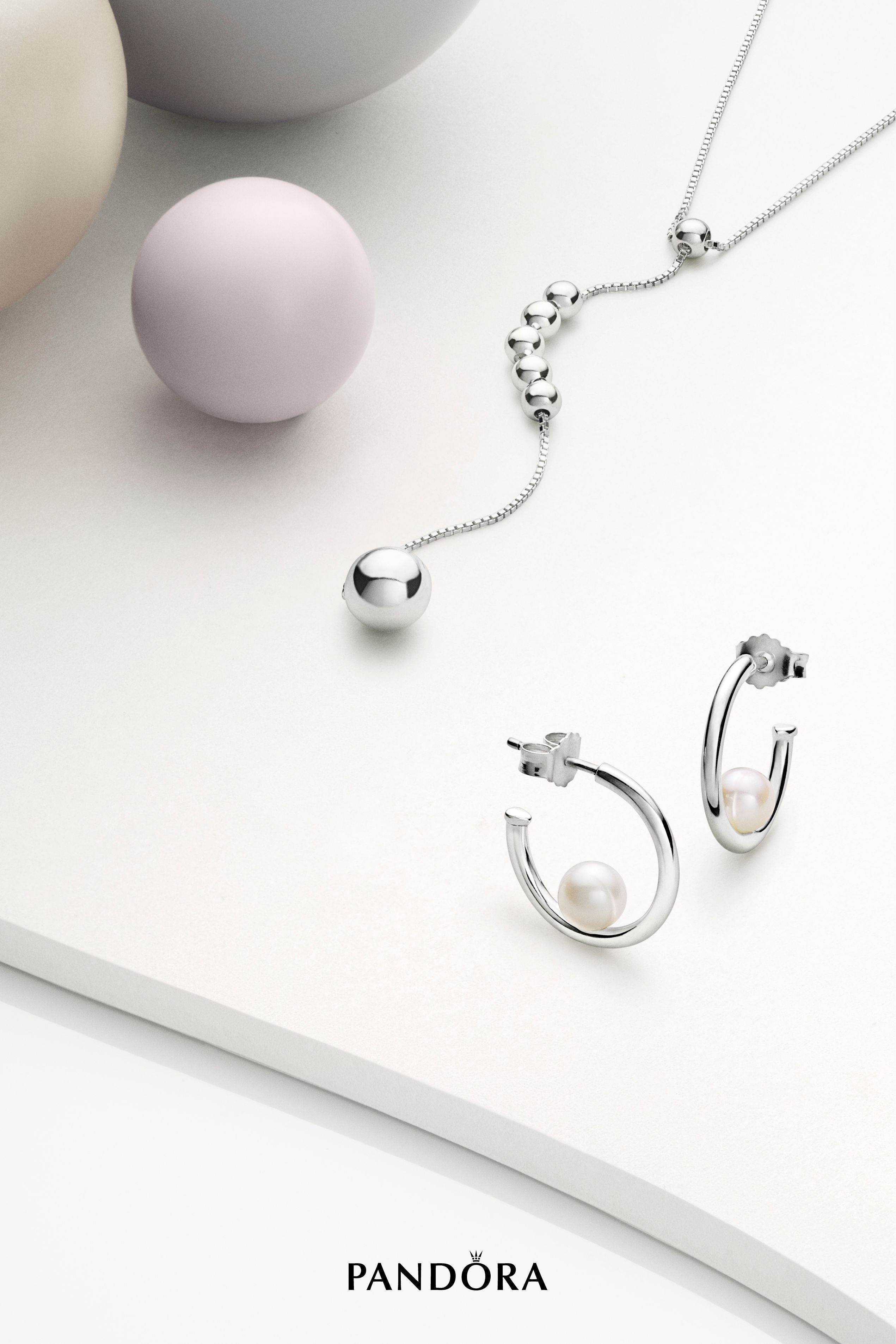 6a76fed05 Contemporary sterling silver hoops receive a timeless twist in our new  Purely PANDORA collection. Freshwater