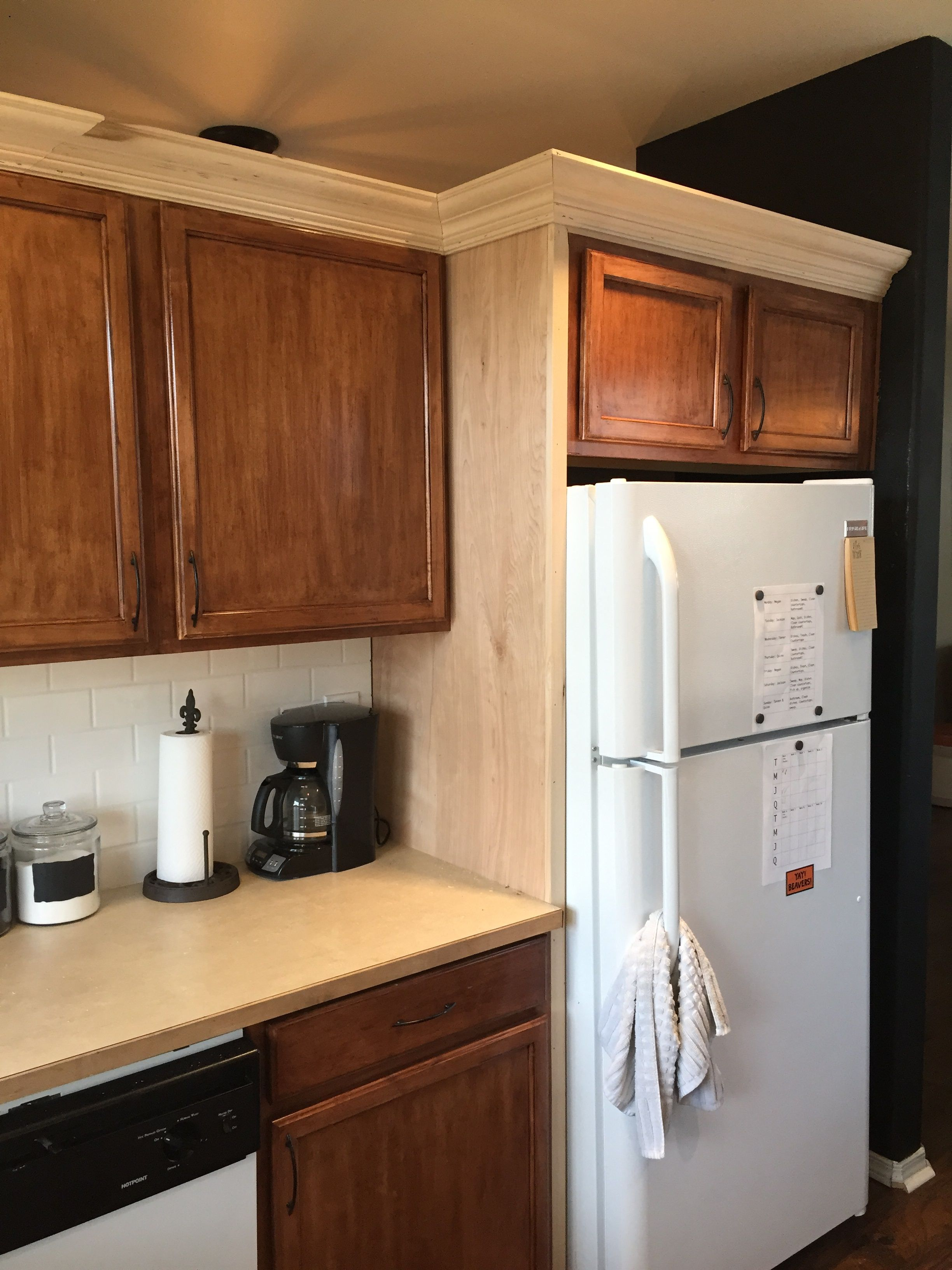 Crown molding and fridge side panel addition to dress up the kitchen ...