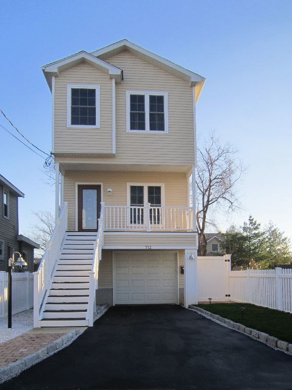 Four Reasons Why You Shouldn T Raise Your Home At The Jersey Shore Narrow Lot House Narrow House Plans Modular Home Floor Plans