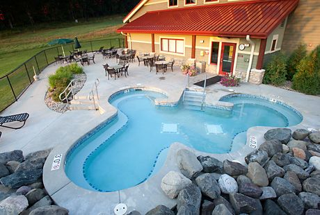 Our Indoor Pool And Outdoor Hot Tub Offer Year Round Aquatic Amusement For You And Your Young Ones F Cabins In Wisconsin Hot Tub Outdoor Resorts In Wisconsin