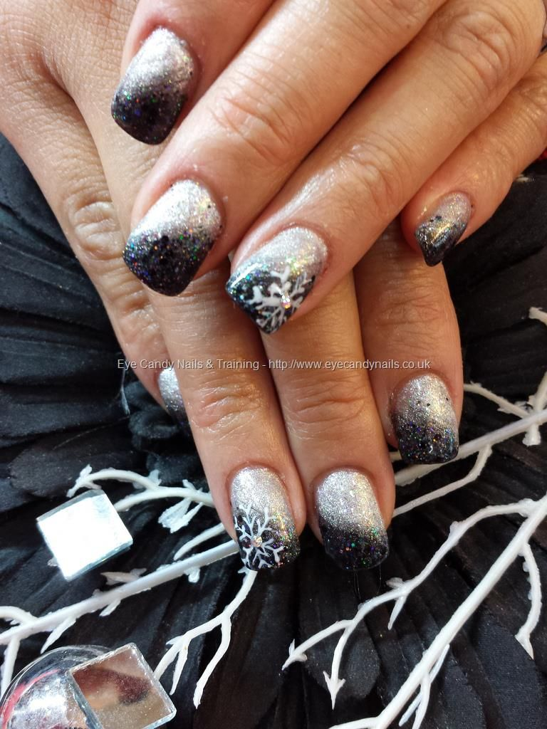 silver and black gel fade with silver glitter and snowflake nail