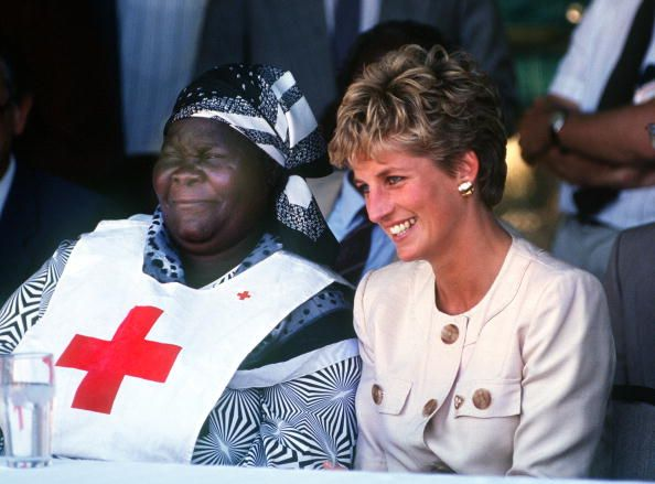 Princess Diana (1961 - 1997) during a visit to the Red Cross borehole project for refugees in Zimbabwe, July 1993. She is wearing a safari suit by Catherine Walker.