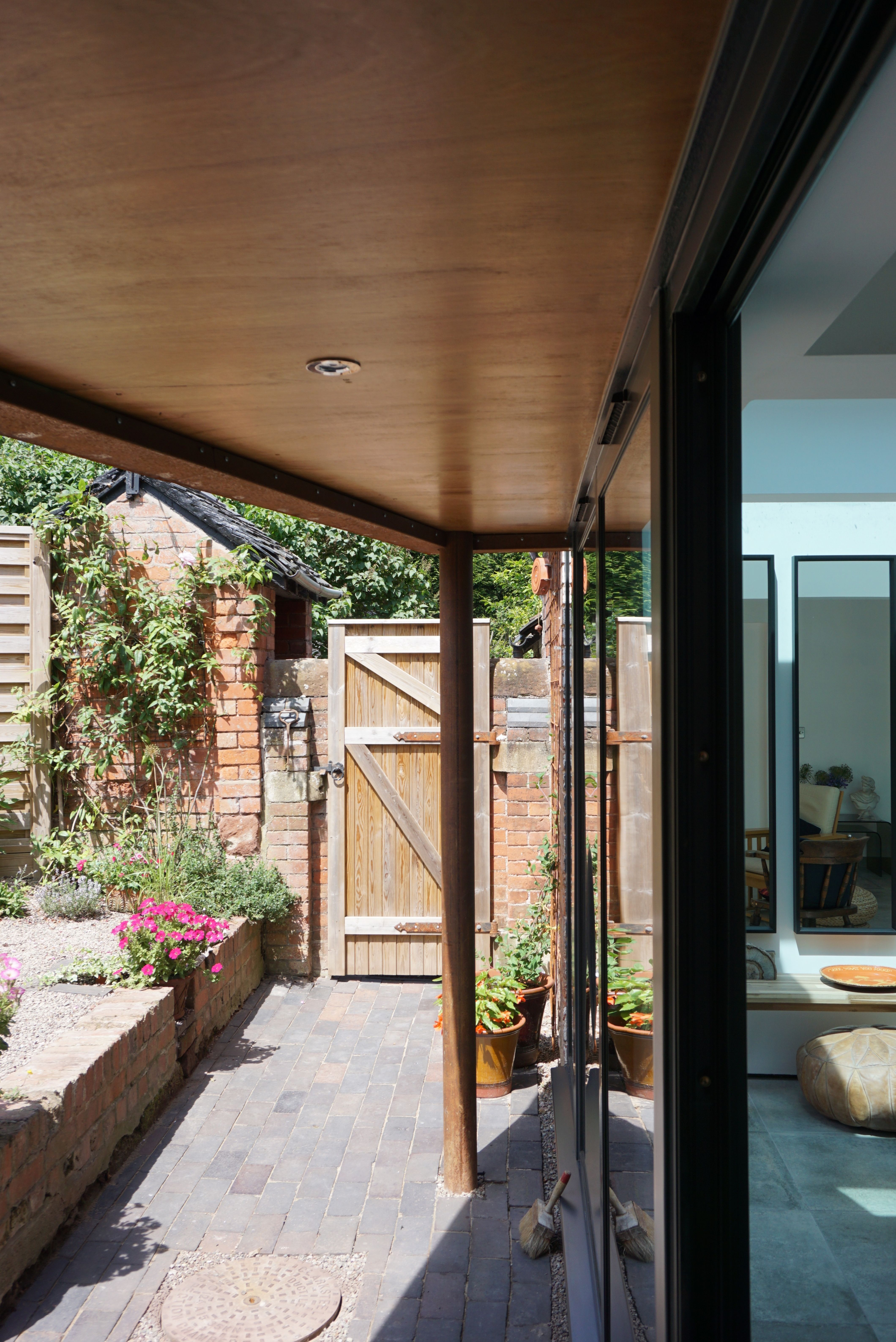 Our 'Corten Extension' project in #MarketDrayton created a new open plan kitchen-diner as part of a side-return and rear single storey build to a Victorian terrace. The Corten blends in beautifully with the existing brick whilst the plan form kicks out towards the garden to create a small sheltered seating area. . #shropshire #formformarchitects #architecture #interiordesign #smallproject  #houseextension #sidereturn #dontmoveimprove #refurbish #remodel #kitchendiner #corten #rooflight