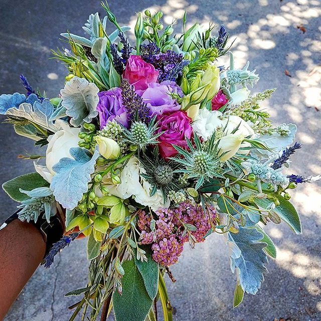 Flowers For A Wedding At The Beach With Bride In Lavender And Attendants Blue