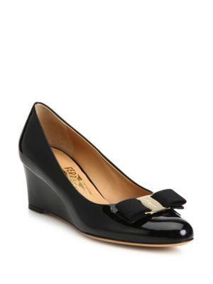 3d8628c73982 SALVATORE FERRAGAMO Mirabel Bow Patent Leather Wedge Pumps.   salvatoreferragamo  shoes  pumps