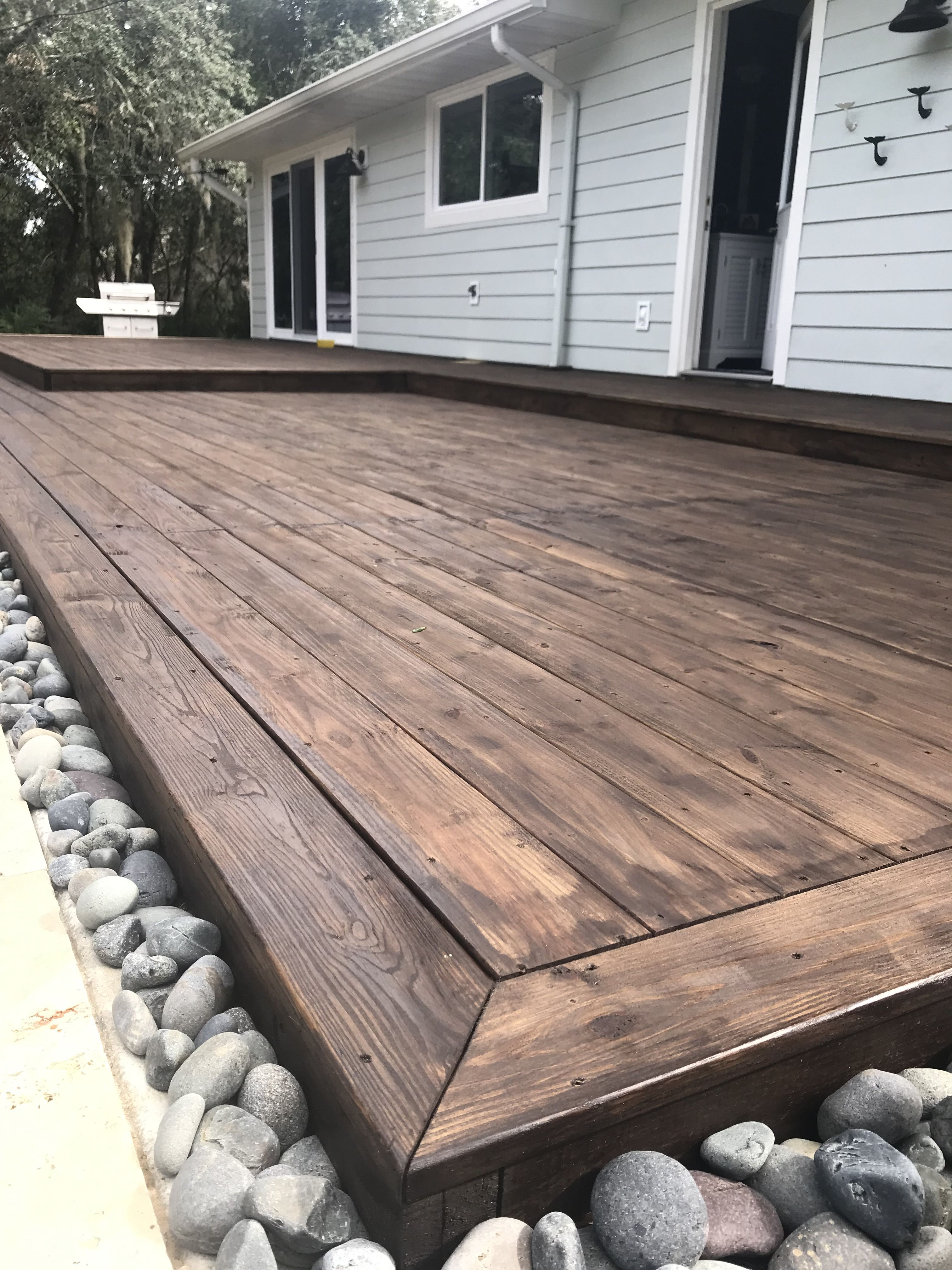 Wood Deck With Mexican Beach Pebbles Stained Deck Restoration Patio Deck Designs Concrete Patio Designs