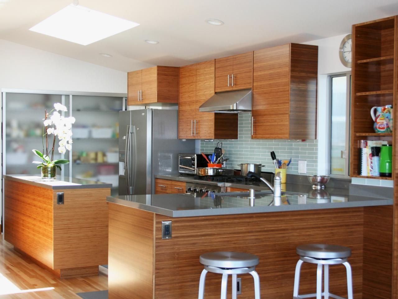 Mid Century Modern Kitchen With Sea Green Glass Tile Backsplash