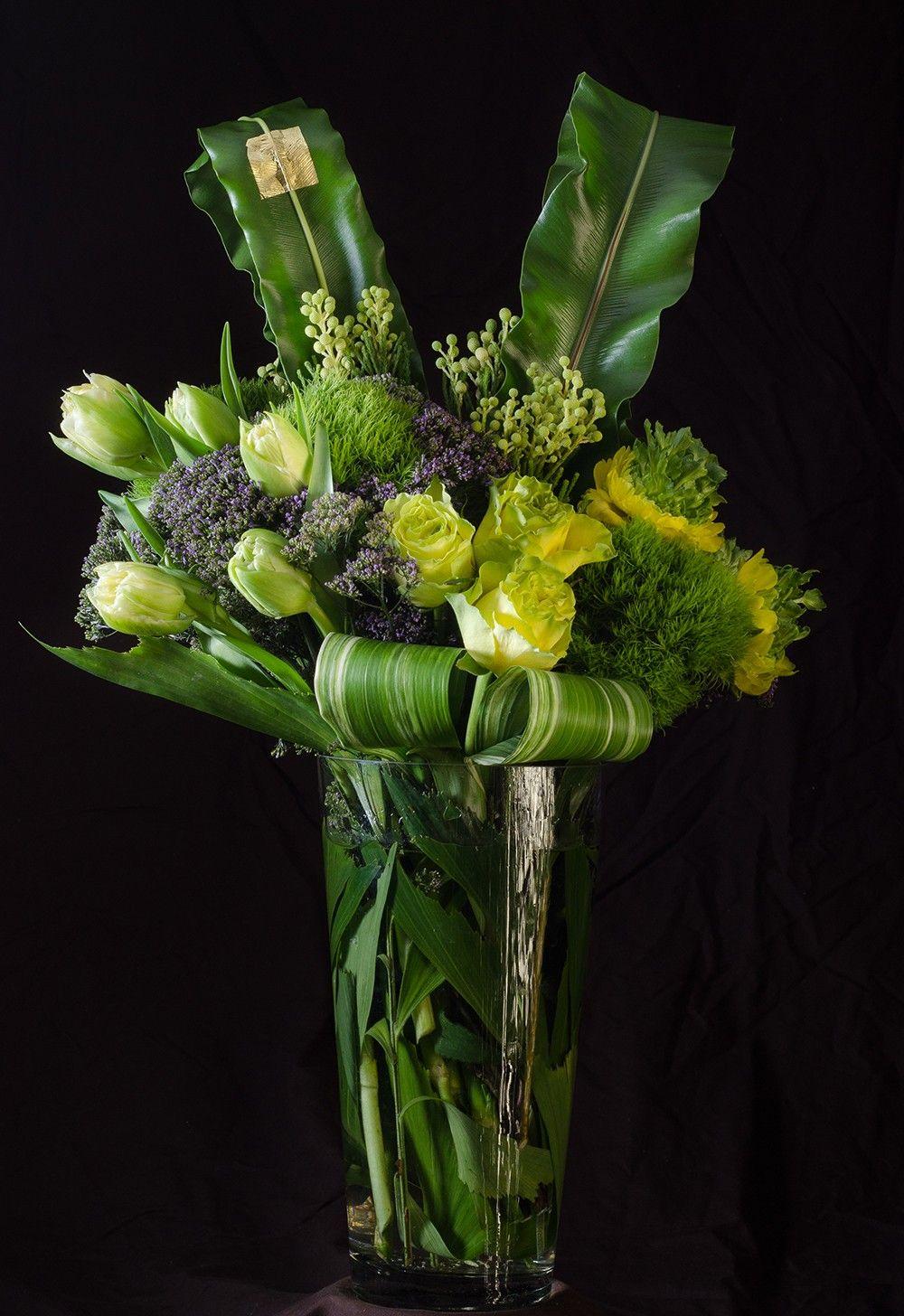 A tall arrangement of spring green flowers with a contemporary look a tall arrangement of spring green flowers with a contemporary look comprised mightylinksfo