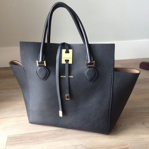 MICHAEL KORS Collection - Miranda tote Beautiful Michael Kors Runway Collection MIRANDA LG TOTE- black with gold hardware - suede interior - used handful of time with no wear- please comment with any questions and responsible offers accepted Michael Kors Bags Totes