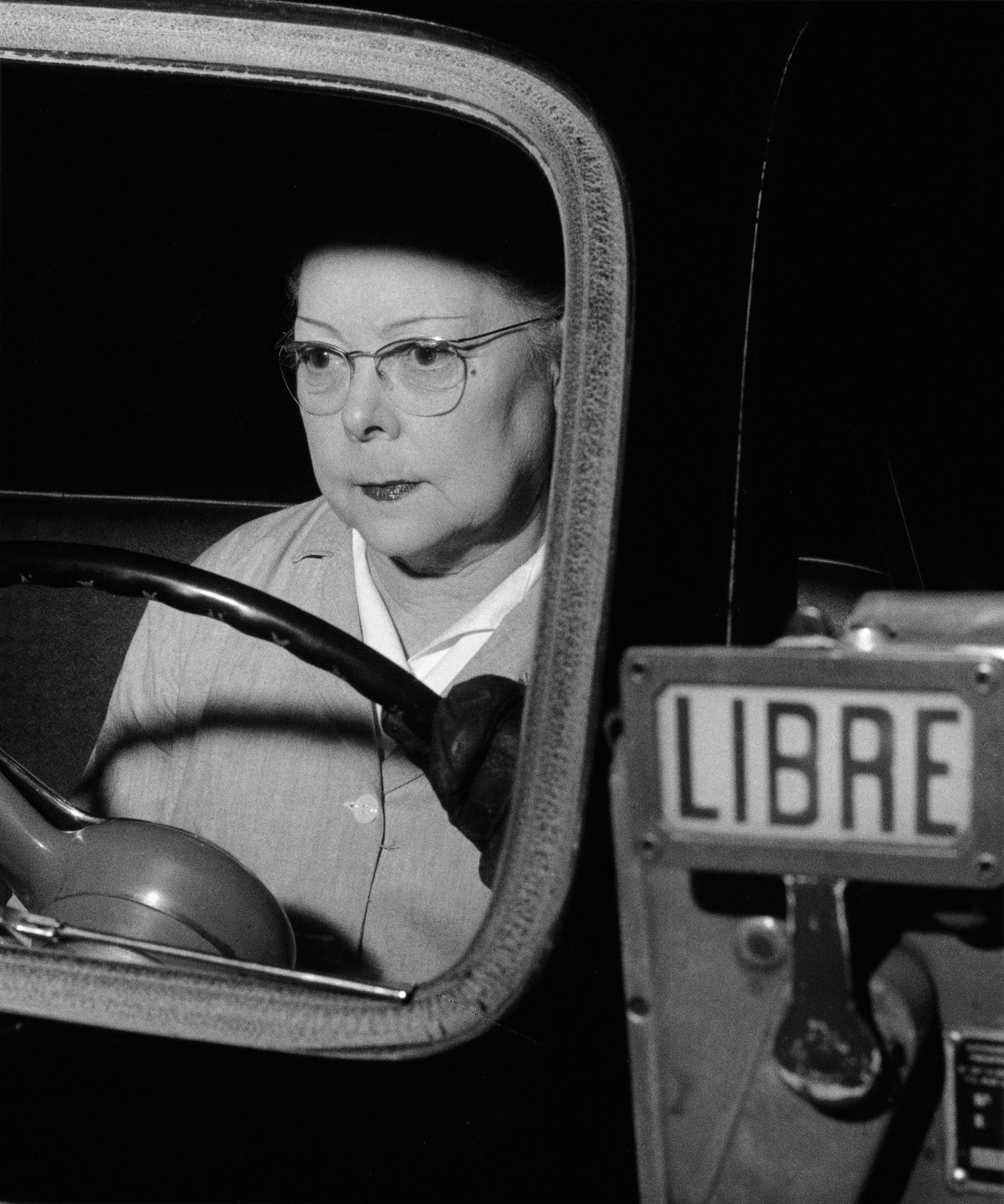 Female taxidriver, Paris, France, 1954 by Nico Jesse