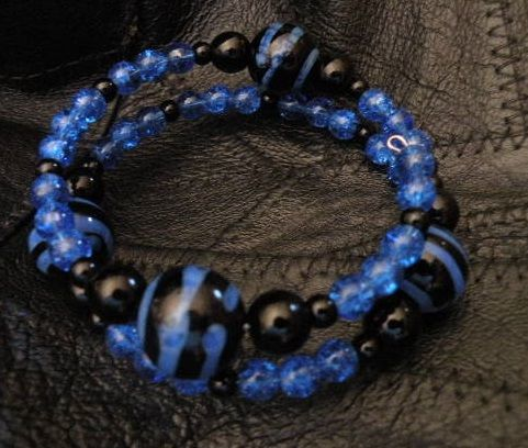 Memory wire bracelet. Two coil wrap around accented with black onyx and black and blue glass zebra themed beads