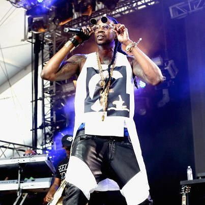 2 Chainz wears #Givenchy Long Tank, #En Noir Leather Pants, and #Gucci Sneakers at 2013 Coachella