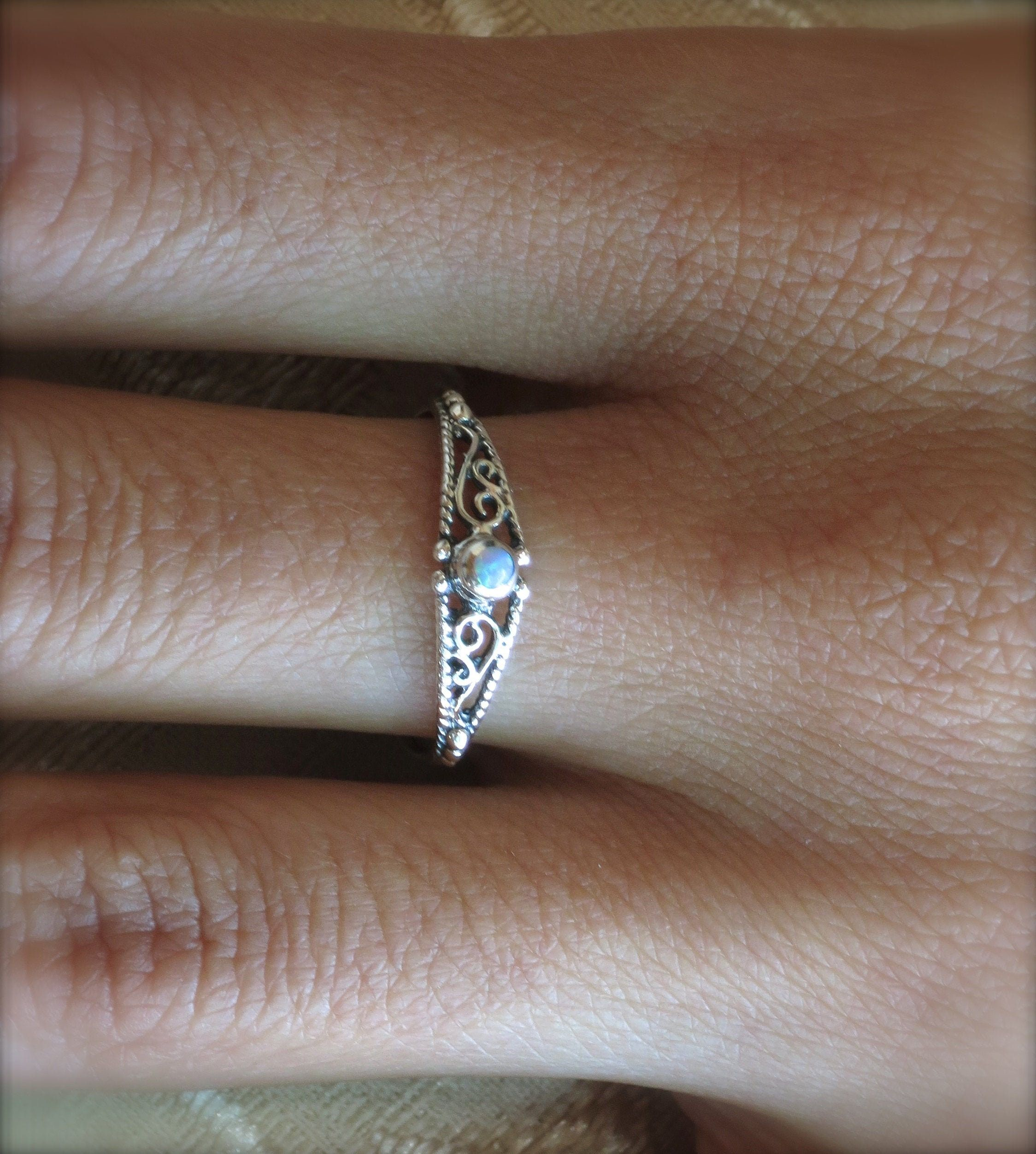 """""""Filigree silver ring, Opal ring, thin ring, classic ring, pretty ring, sterling silver, Boho Opal silver ring. weight- 0.6g width-5mm L-35 stone size- 2mm Opal-the birthstone for October encourages stable, strong and positive communication. provides stability and happiness. 🌸 Features: Handmade ring 🌸 Measurements: Weight - 0.6g Width of the ring at the top - 0.19\"""" (5mm) Stone diameter - 0.07\""""(2mm) 🌸Materials: Sterling Silver Blue Opal 🌸 More info: All my jewelry is carefully wrapped and"""