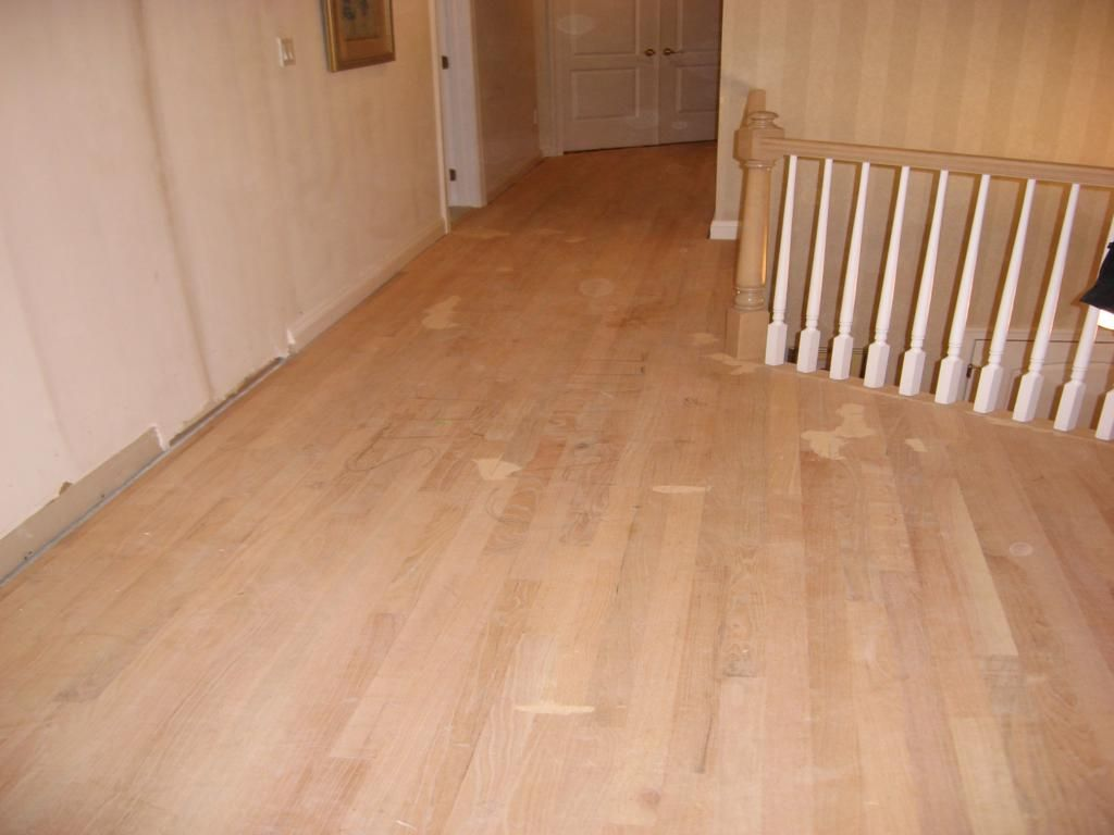 This Is A Wide Angle View Of The Newly Installed And Properly Puttied Unfinished 2 1 4 Red Oak Red Oak Hardwood Red Oak Hardwood Floors Oak Hardwood Flooring