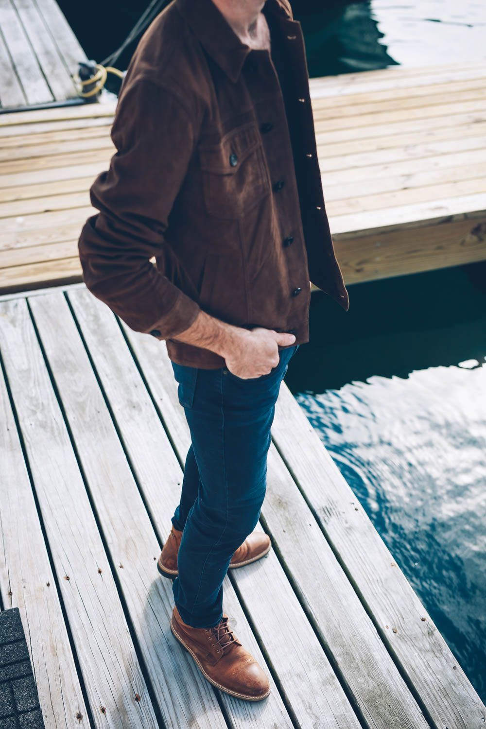 Craig Mackay wearing Timberland boots and a Paige Denim suede jacket