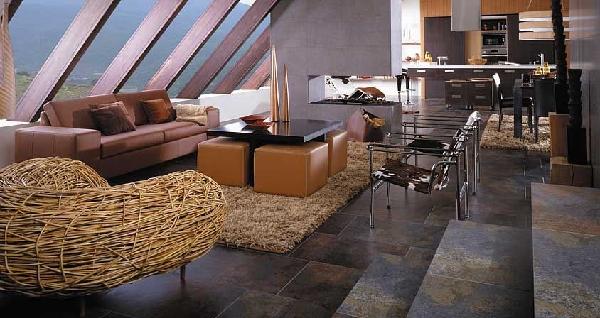 these stone floor tiles reflect so many different colors and add personality to this living room the tiles are relatively dark but with so many colors - Dark Tiles Living Room