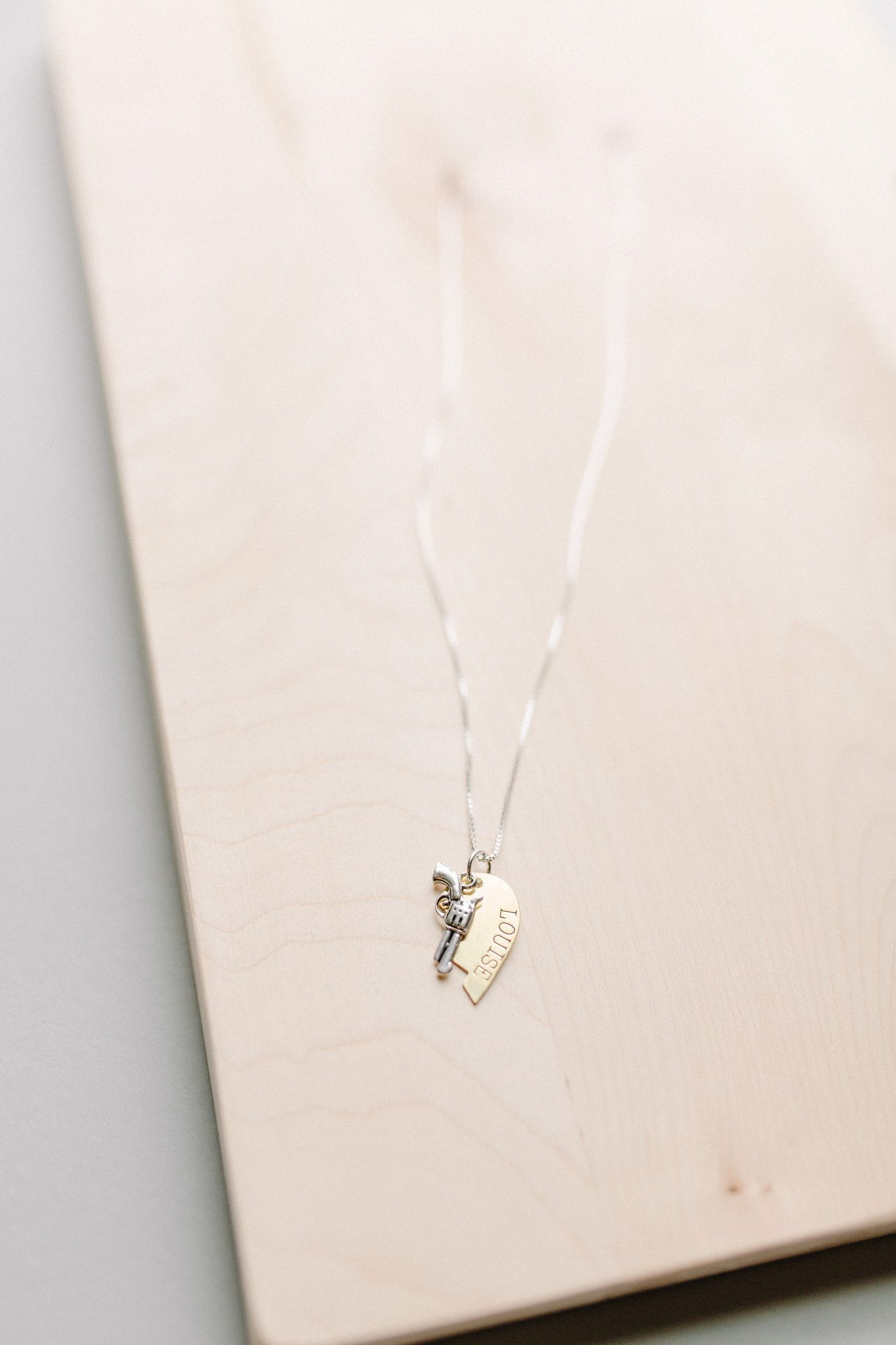 Do you have a special person that brings out the Rebel in You? This Thelma & Louise paired necklace is the perfect celebration of your unique friendship. Hand stamped, this shiny brass and silver combo make this the perfect match for any outfit. Each order contains two heart necklaces - one for Thelma and one for her Louise. 18 inch Sterling Silver Chain  Brass Engraved Split Heart Sterling Silver Revolver Free shipping on qualifying orders. #bourbonandboots