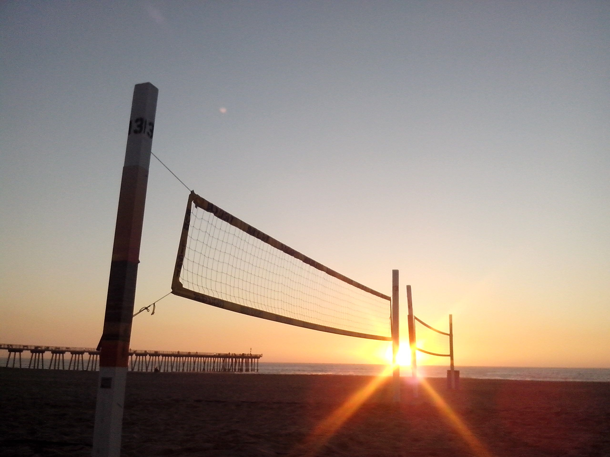 Sunset Over Beach Volleyball Courts In California Sunset California Hermosabeach Beach Volleyball Court Beach Volleyball Beach Sunset
