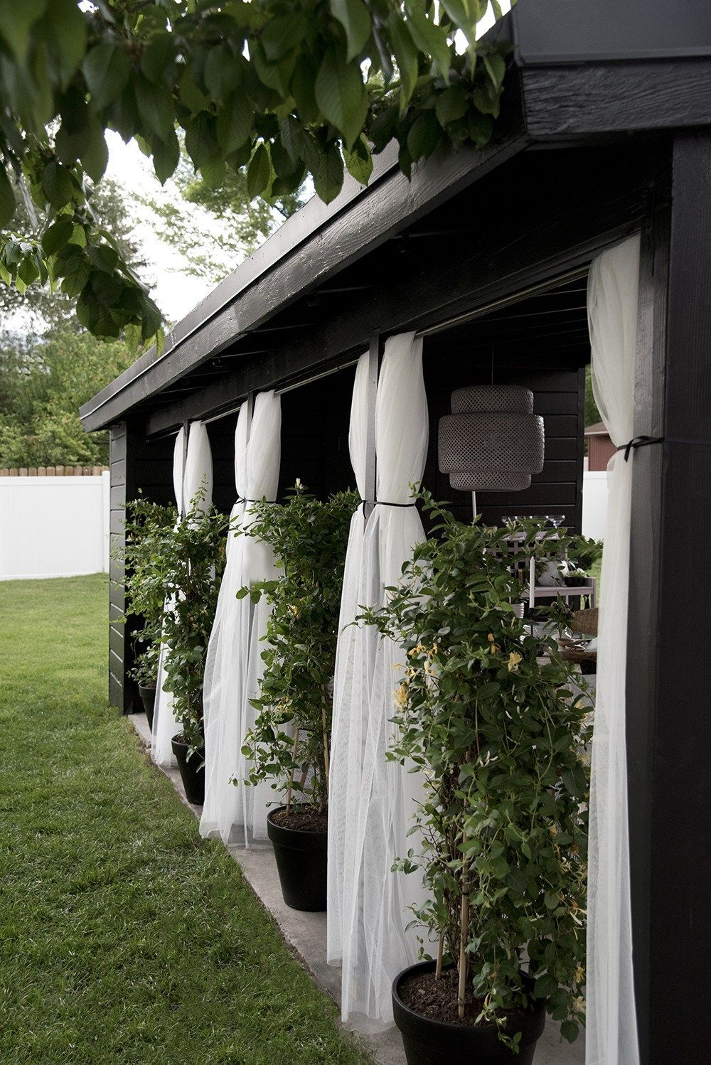 Carport Makeover Outdoor Sheer Curtains Potted Honeysuckle And An Intimate Dining Area Carport Makeover Carport Patio Outdoor Curtains