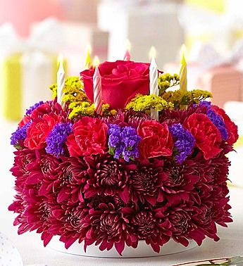 Birthday Flower Cake®   Be the reason their birthday takes the cake! Crafted from fresh roses, mums, carnations and more, our truly original floral arrangement looks good enough to eat—and even arrives in a bakery box with a set of candles. Add a festive balloon for an extra sweet celebration.