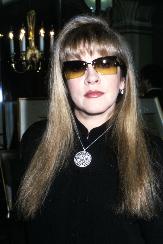 Stevie  ~ ☆♥❤♥☆ ~   perfectly groomed and made-up, wearing her prescription sunnies and a silver medallion at function, date unknown