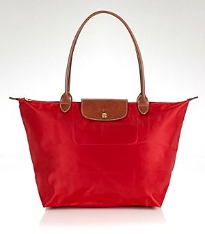 It S Stylish I First Saw An Incredibly Chic Penger With A Well Worn Large Travel Handbagsthe