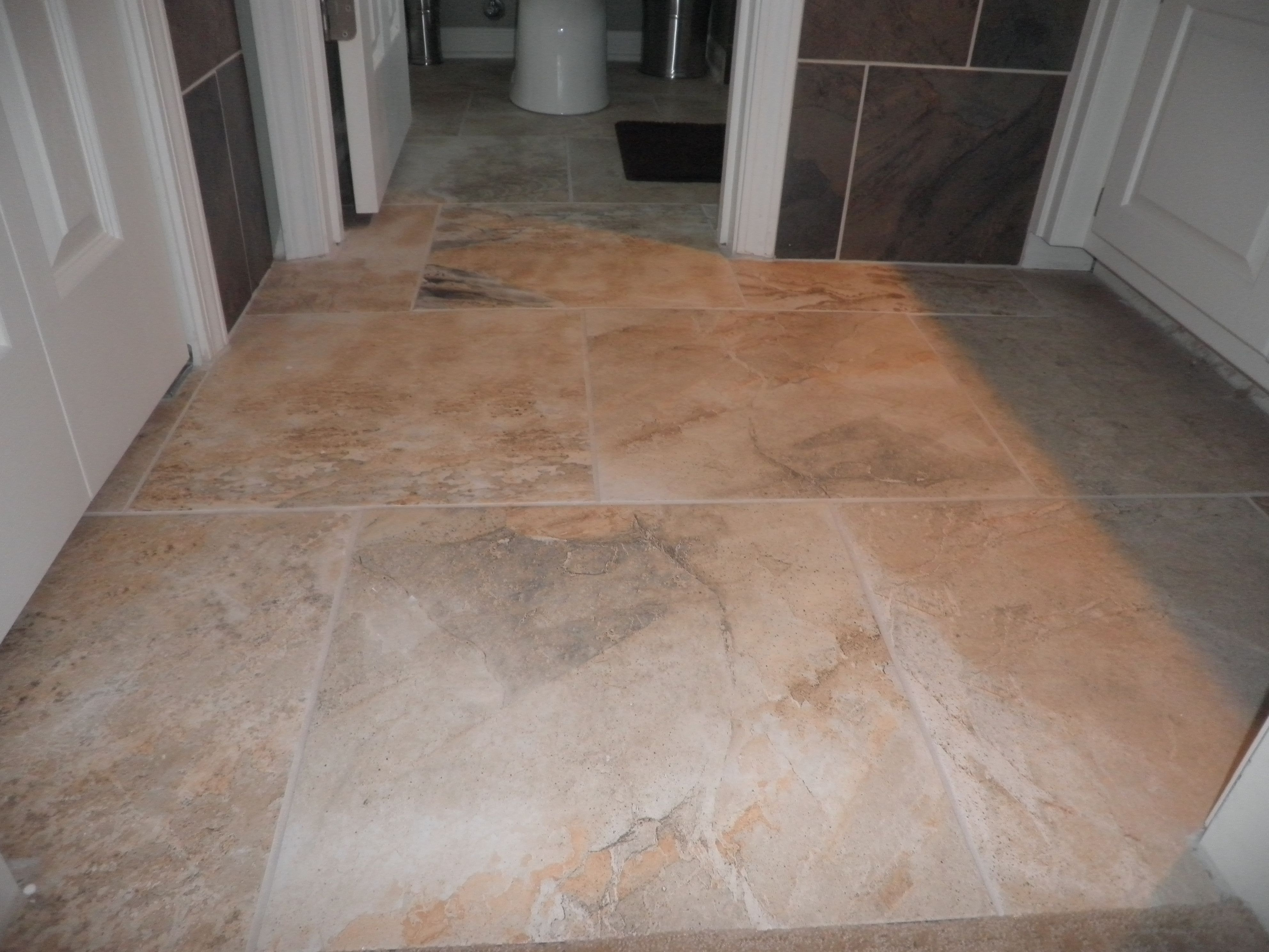 Using larger sized floor tiles works well with a compact sized