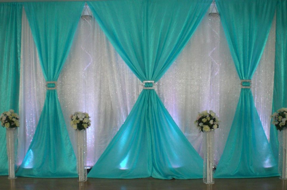 Aqua White And Crystal Panels With White Wedding Flowers