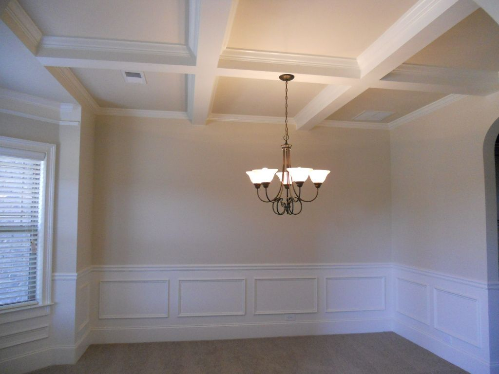 The Dining Room Is Appointed With Coffered Ceilings And Shadow Box Molding.