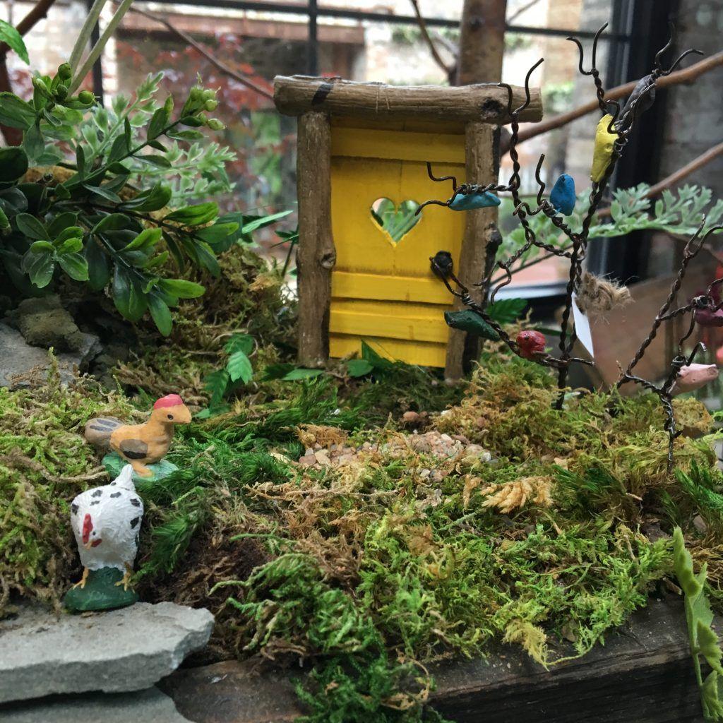 Free range chickens inhabit this miniature garden. Love this ...