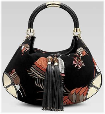 c74c13a96 The Gucci Indy Bag above shows off multicolor blue bell embroidery with  bamboo tassels and metal plate details.