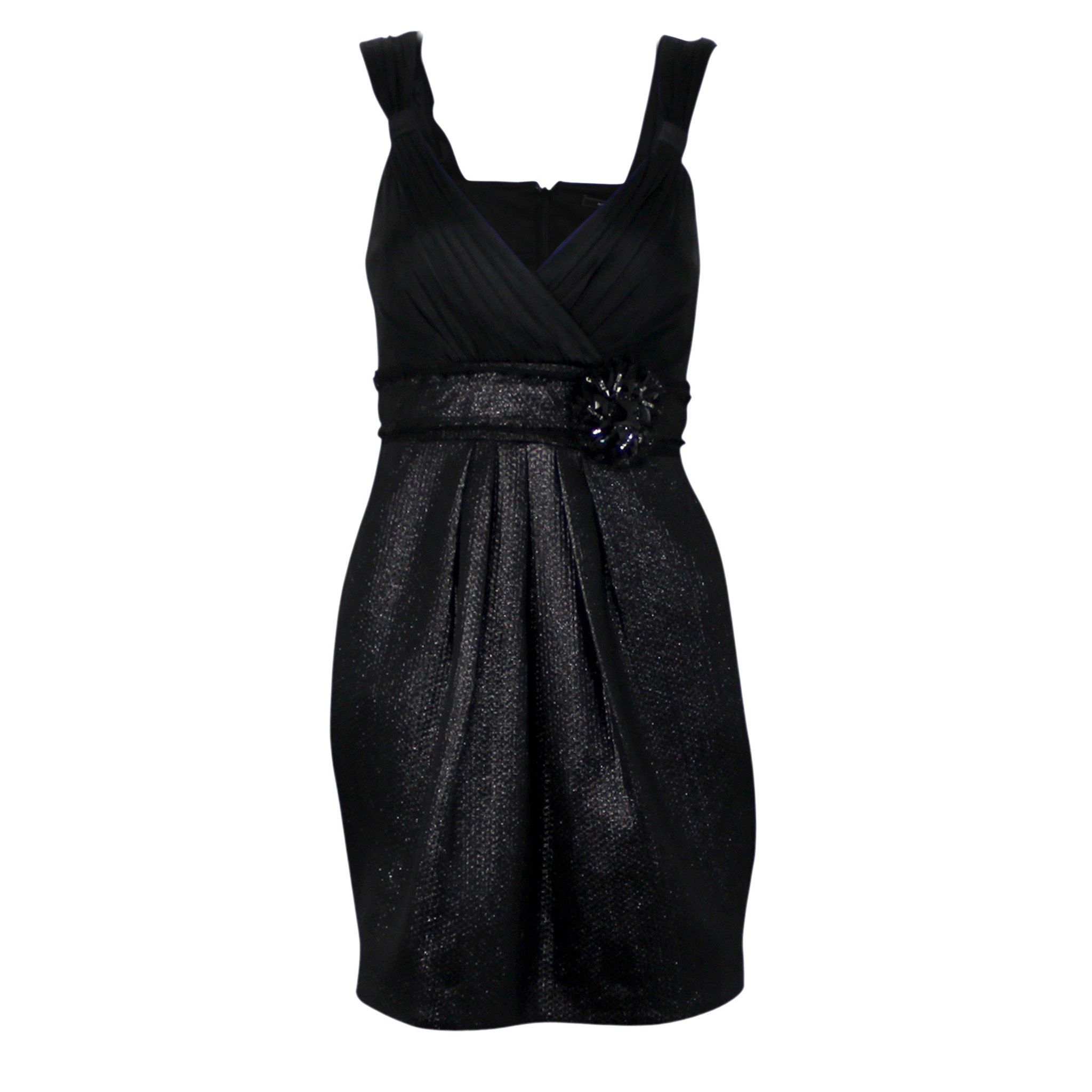 A V-Neck cocktail dress featuring a jersey pleated bust, a jaquard skirt with fringe detail and applique at waist, a pleated skirt, slant hip pockets, and a hidden back zipper. Condition: New without