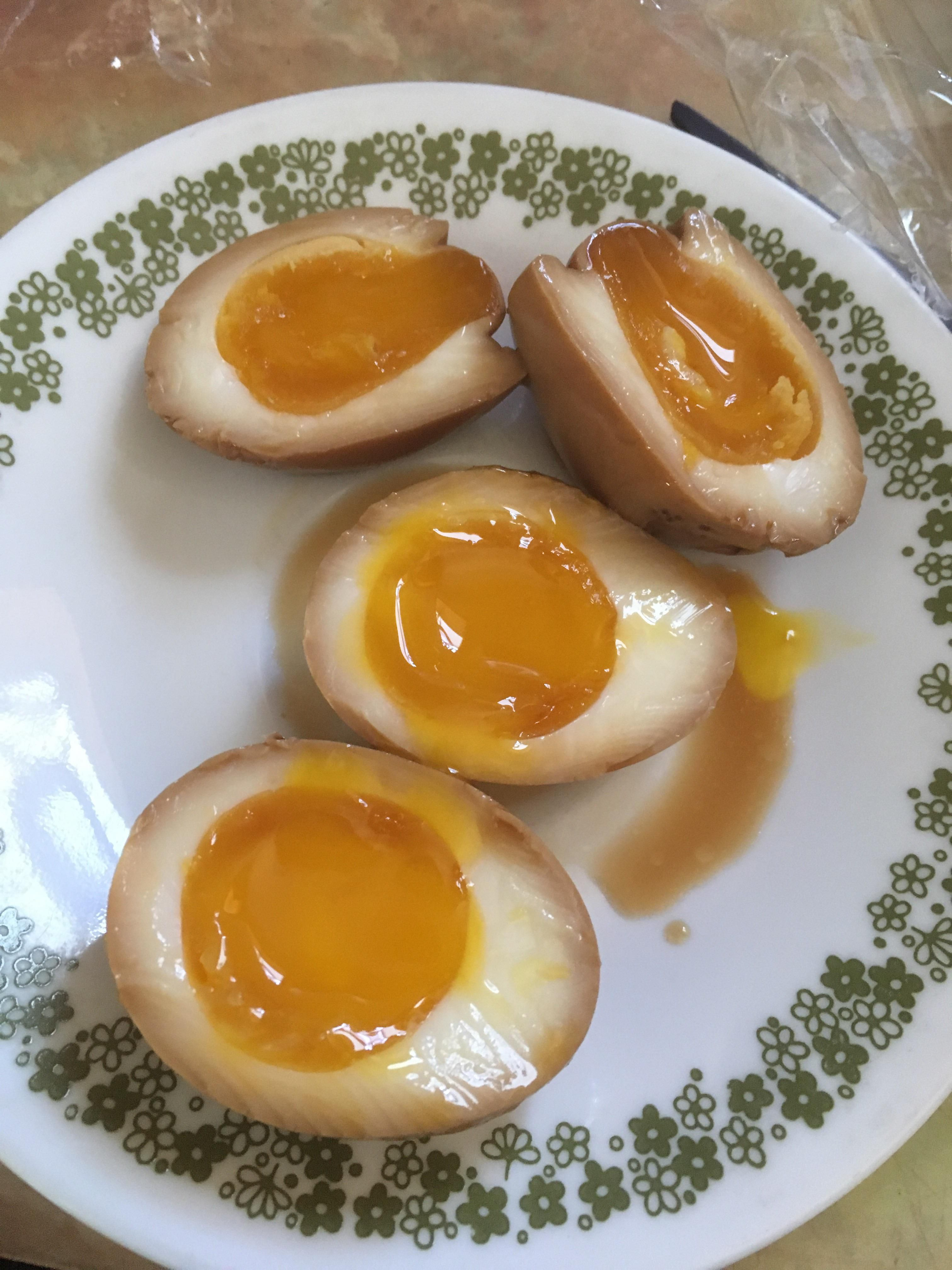 Soft boiled eggs marinated in soy sauce and sugar overnight