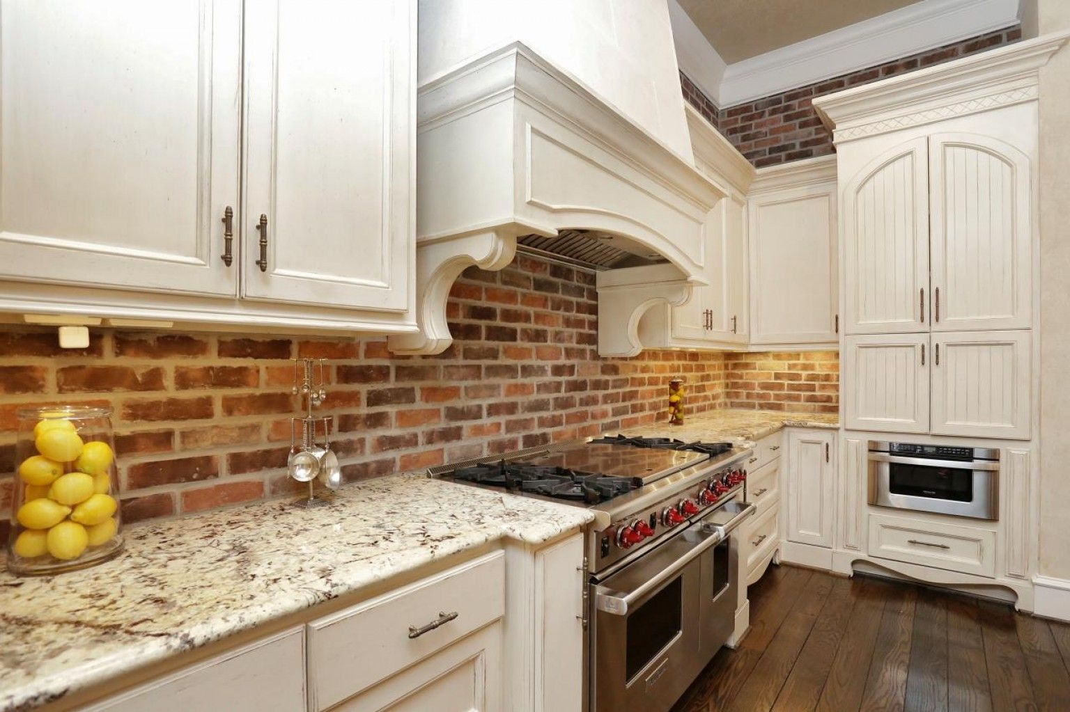 Brick Backsplash With White Cabinets Tuscan Kitchen In