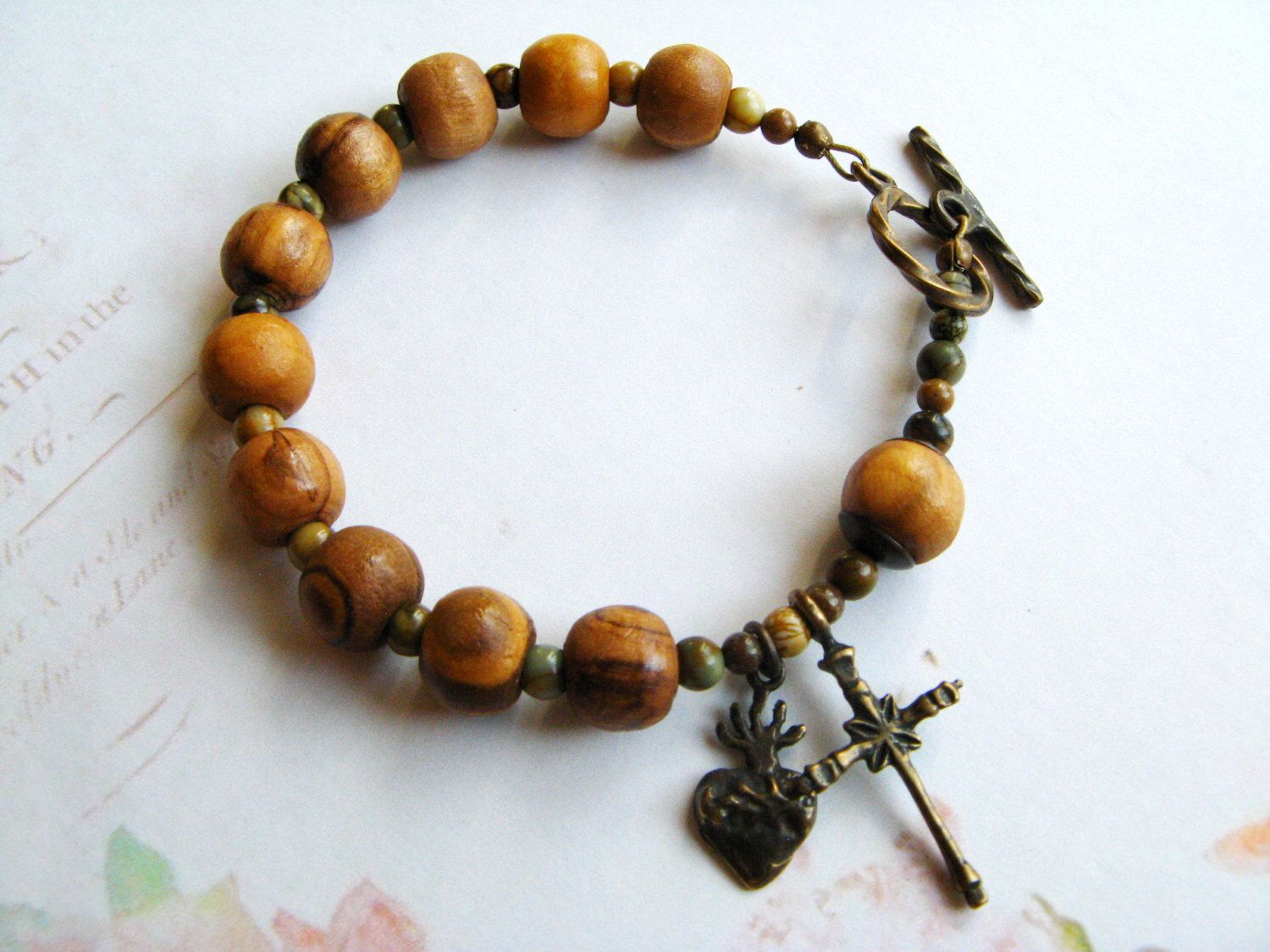 Olive Wood Catholic Rosary Bracelet - One Decade, Bronze Sacred Heart by RachelRode on Etsy https://www.etsy.com/listing/163443407/olive-wood-catholic-rosary-bracelet-one