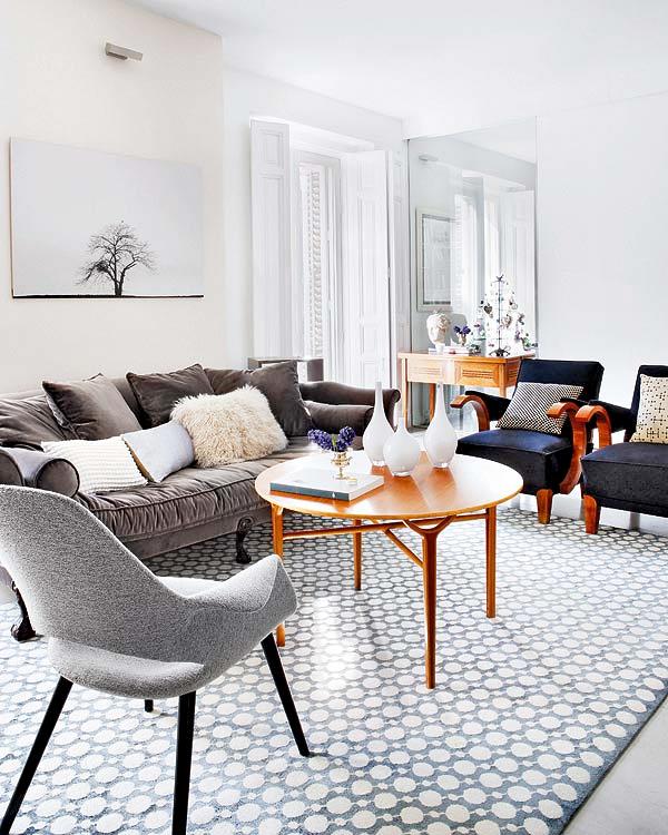 plush, velvet sofa in greige, navy chairs, grey floor, neutral rug ...