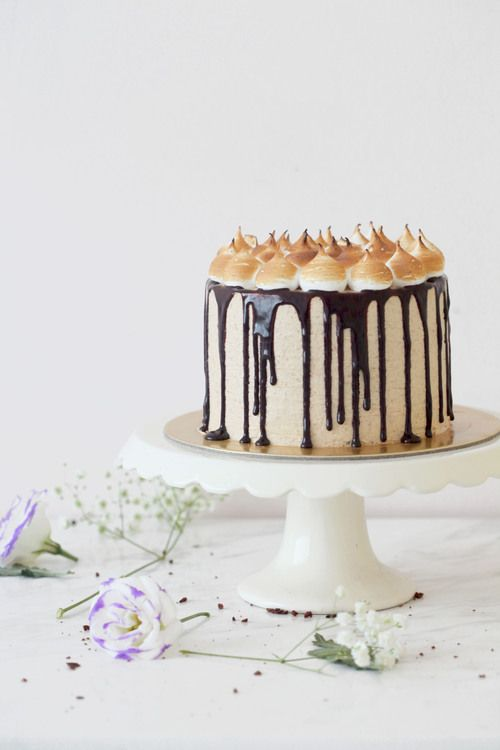 s'mores layer cake with digestive biscuit cream frosting chocOlate fudge sauce swiss meringue & charred marshmallows