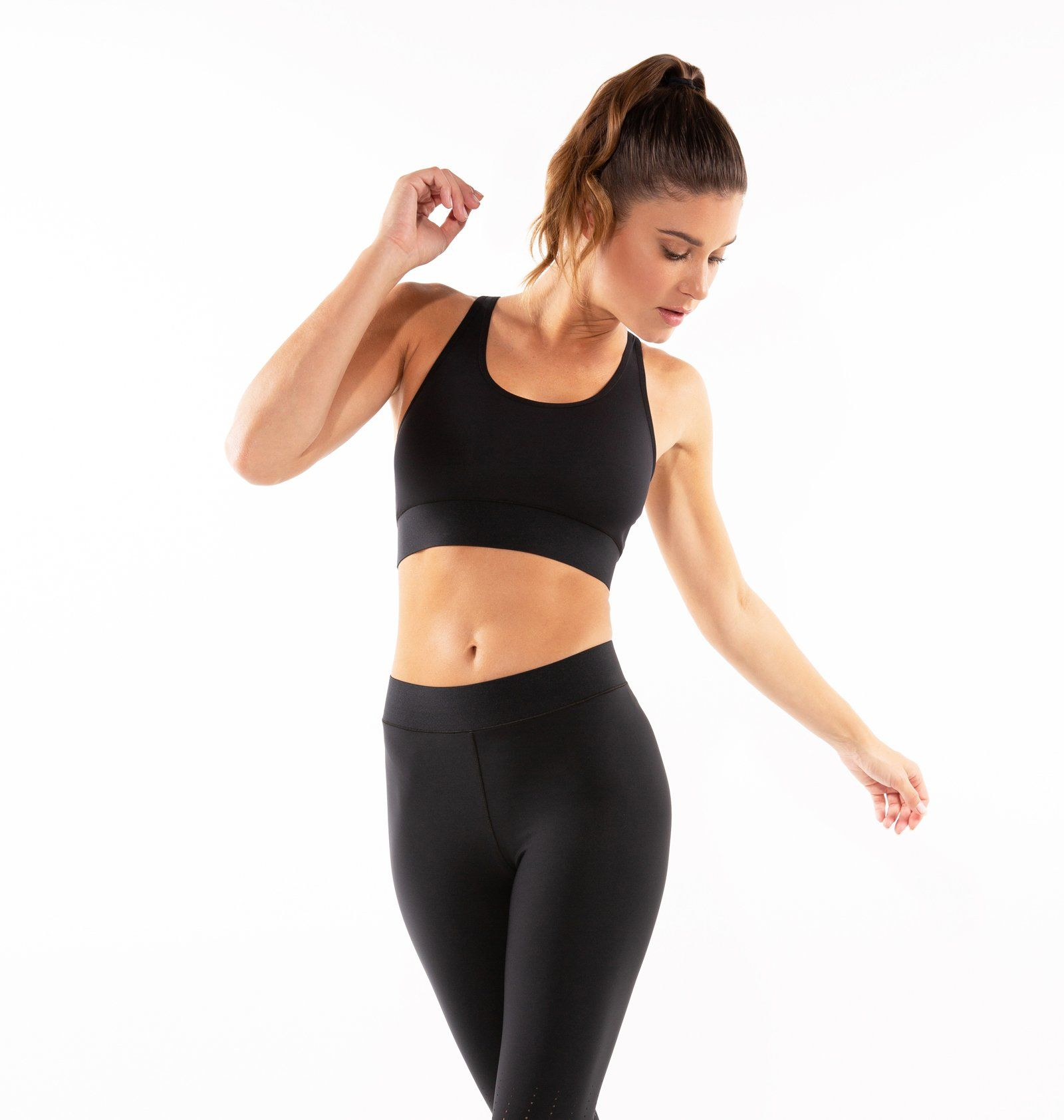Best 12 A medium support sports bra with a scoop neck front and cut out back design. Wear the Terrain Lux Bra under