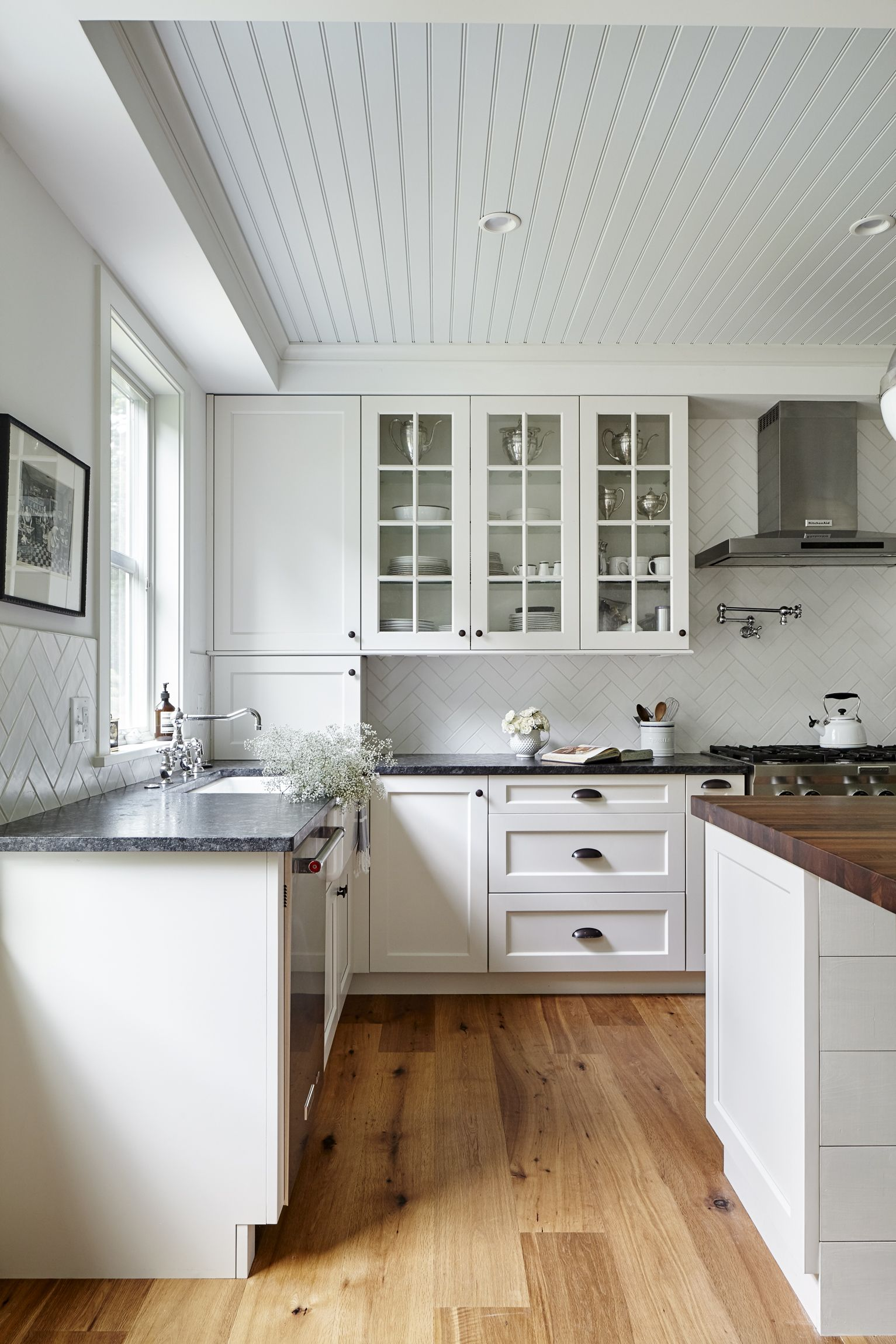 Kitchen with leathered granite counters, walnut butcher block island ...