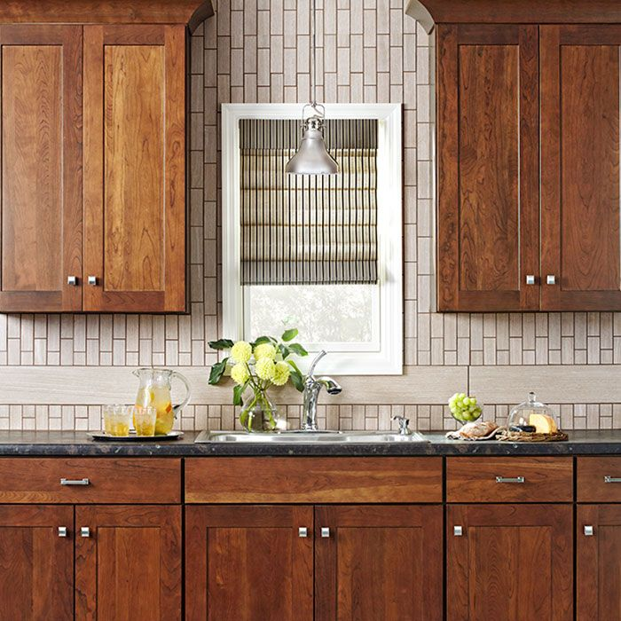 Natural Wood Finish Cabinets With A Subway Tile Backsplash