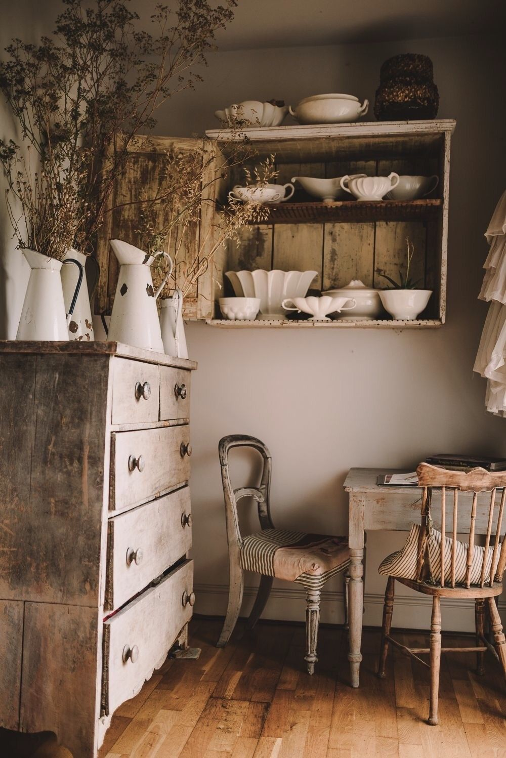 Enamelware pitchers in white with with brown