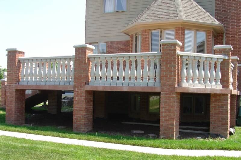 European Style Raised Concrete Deck With Brick Columns And Cement  Balustrades.